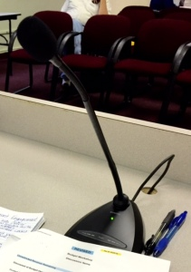 Board members and the Superintendent each have a microphone that clearly records audio of Board meetings.